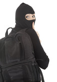 female thief in black balaclava with stolen backpack