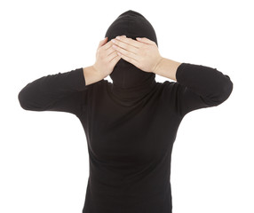 female thief in black clothes covering eyes, white background