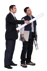 businessman giving explanations to a craftsman