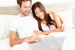 Bed couple with laptop