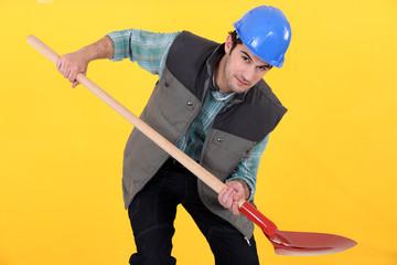 Tradesman holding a shovel