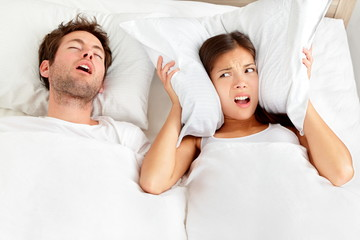 Snoring man - couple in bed