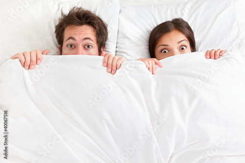 canvas print picture Funny surprised couple in bed