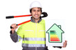 Man with bolt-cutters and energy rating poster
