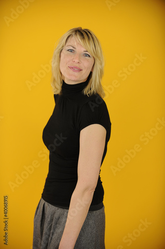 woman posing on yellow background
