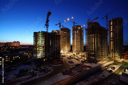 Seven high buildings under construction with cranes