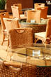 wicker chairs and table in empty comfortable restaurant