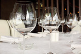 glasses at table with white tablecloth in restaurant