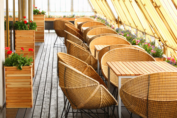 Beautiful spherical wicker chairs and tables at terrace