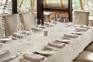beautiful serving at table with tablecloth in empty restaurant