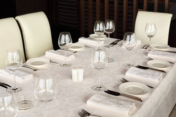beautiful serving at table with white tablecloth in restaurant