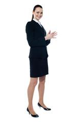 Full length of corporate smiling woman