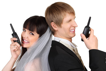 Dissatisfied young groom and bride speak on radio isolated