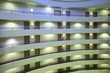 Stories in large hotel, balconies and rows of indentical doors