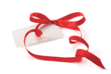 A blank tied with a bow of red ribbon