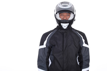 Motorcyclist wearing black jacket and helmet