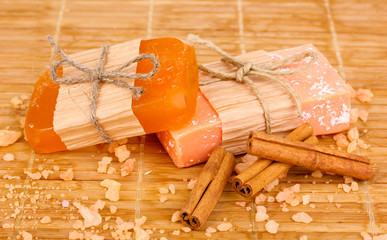 Hand-made natural soaps on wooden mat
