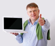 Man presenting laptop isolated on white background