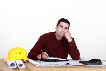 Disinterested worker in office