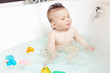 Cute baby showing tongue while taking a bath