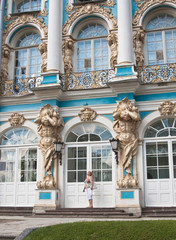 A tourist on the steps of the Great Catherine Palace. Tsarskoye