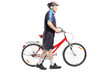 Full length portrait of a senior bicyclist pushing a bicycle