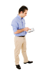 Young man full body using a tablet computer against white backgr