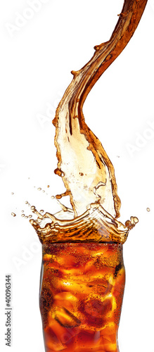 Pouring cola into glass, isolated on white background