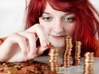 Pretty young teenager is counting her pocket money