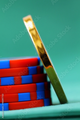 gambling chips and a gold chip on a green background