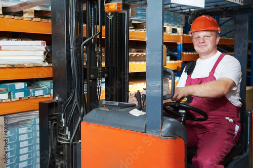 warehouse forklift worker at work