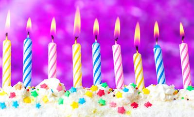 beautiful birthday candles  on purple background