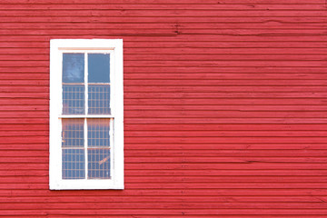 White Window on Red Siding