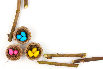 Colorful easter eggs in nests isolated on white