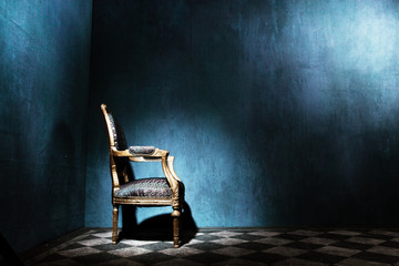 Louis style armchair in blue room