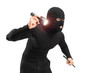Robber with robbery mask holding a flashlight and piece of pipe