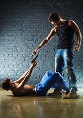 Men with guns fighting
