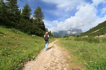 Dolomites - girl on a mountain pathway