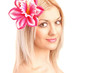 Beautiful face of young woman with flower in her hair