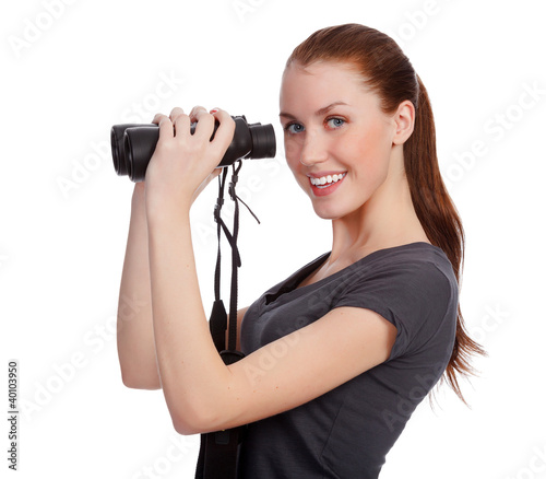 Smiling girl with binoculars