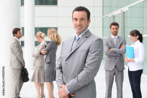 Group of business people stood outside building