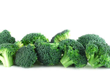 Broccoli pices in row on white
