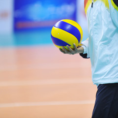 volleyball in hand