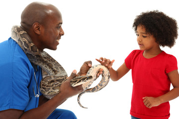 Black Male Vet Holding Snake With Young Child