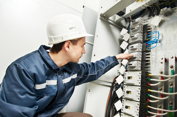 Electrician switching on  power line box