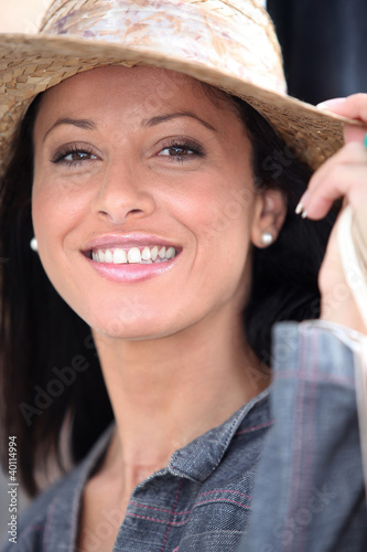 Attractive brunette wearing straw hat