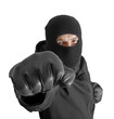 Masked criminal with clenched fist, isolated on white