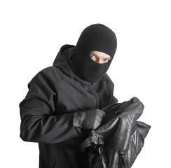 Masked criminal holding a stolen handbag, isolated on white