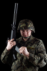 Soldier reloading magazine of m16