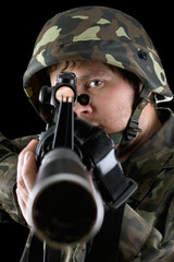 Man pointing a rifle